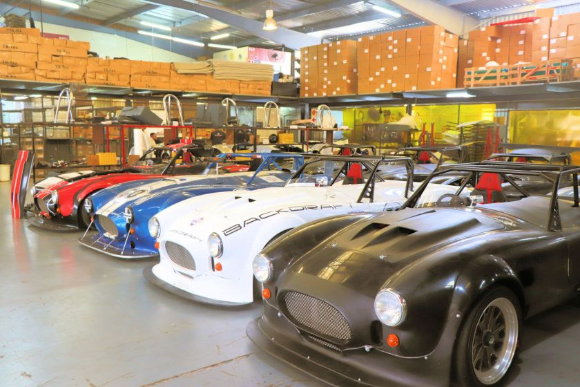 Loan race cars in the Backdraft Racing workshop